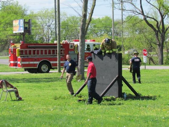 Firefighters training in a park