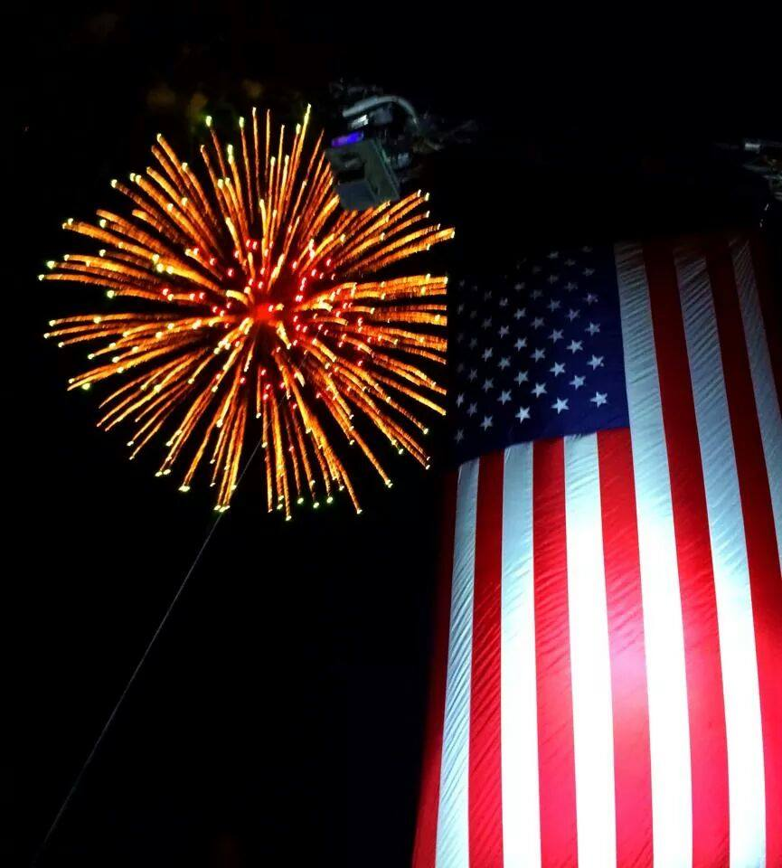image of American flag and fireworks
