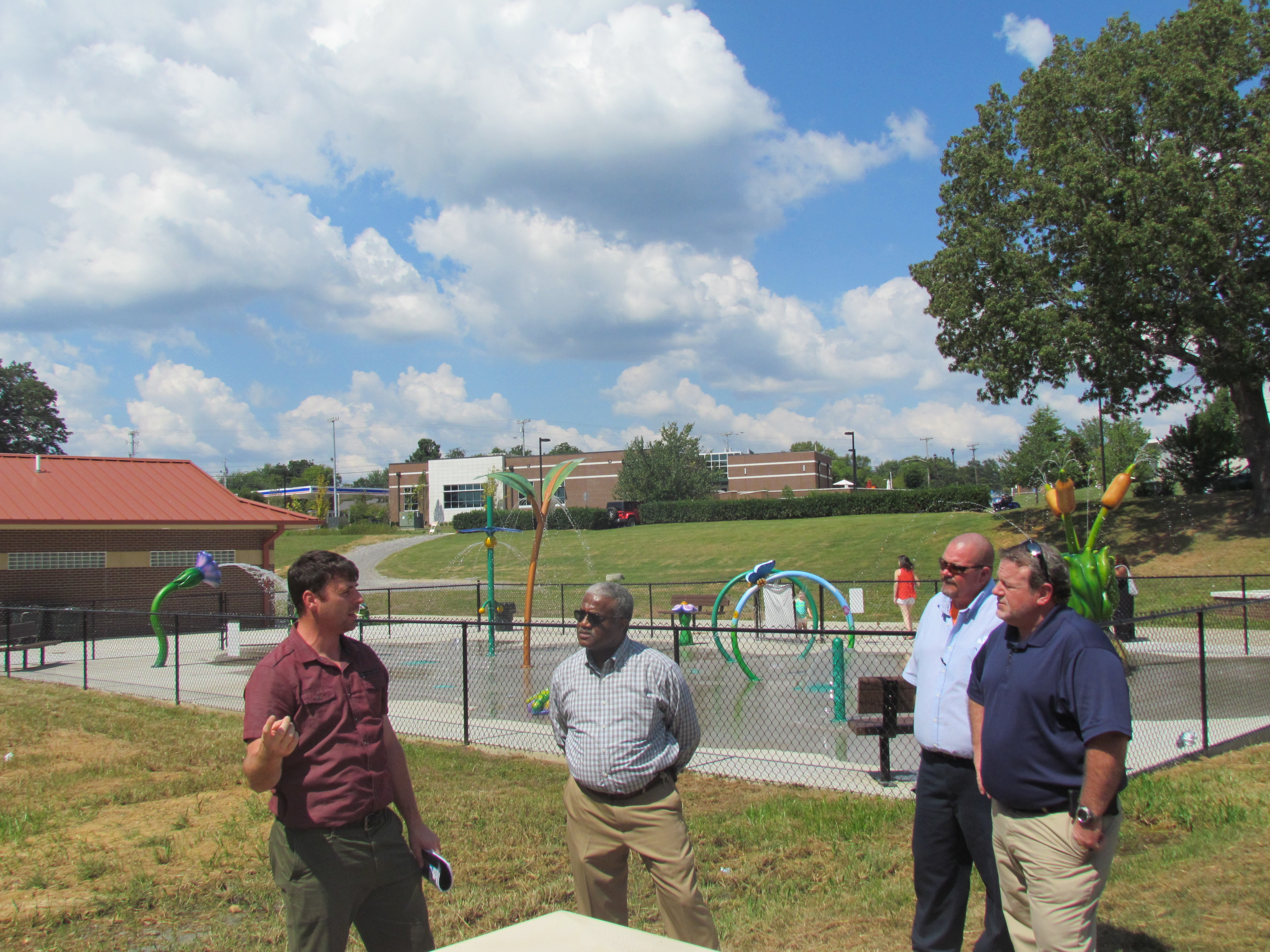 image of staff and Officals visiting a splash pad