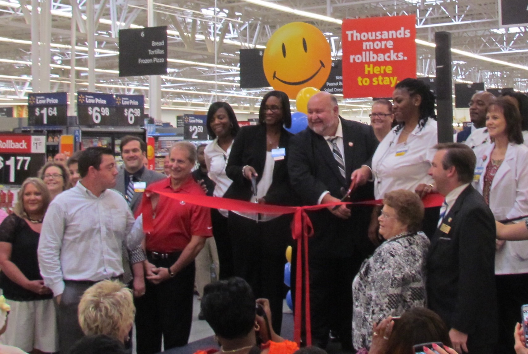 image of Mayor Waldron cutting ribbon  at Wal-Mart grand opening
